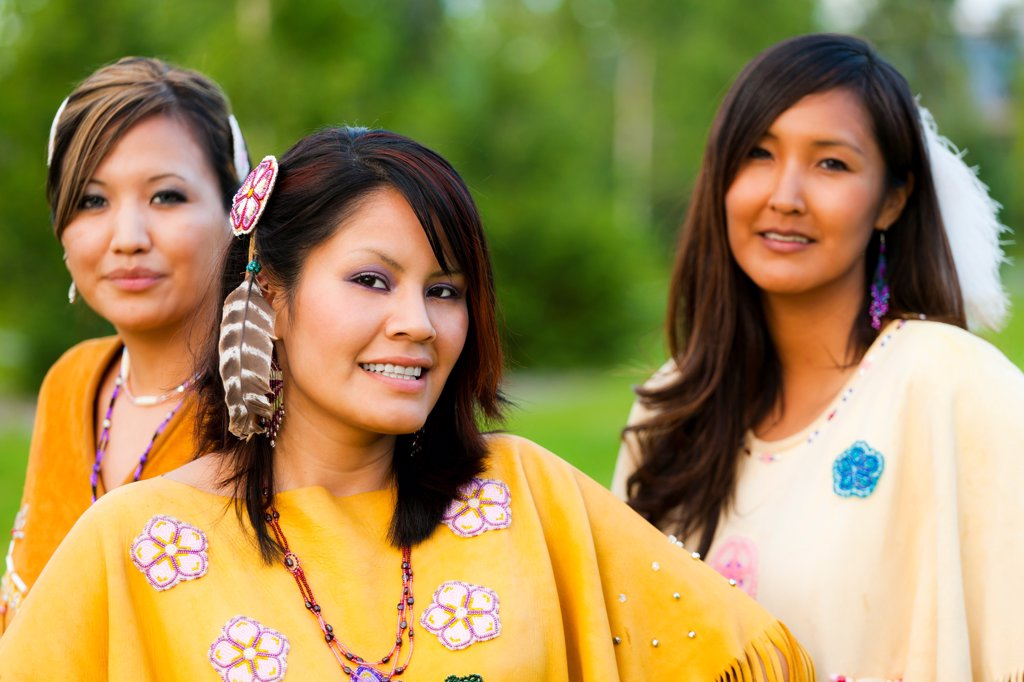 Female Athabascan dancers pose at the Morris_Thompson Cultural Center, Fairbanks, Interior Alaska, Summer : Stock Photo