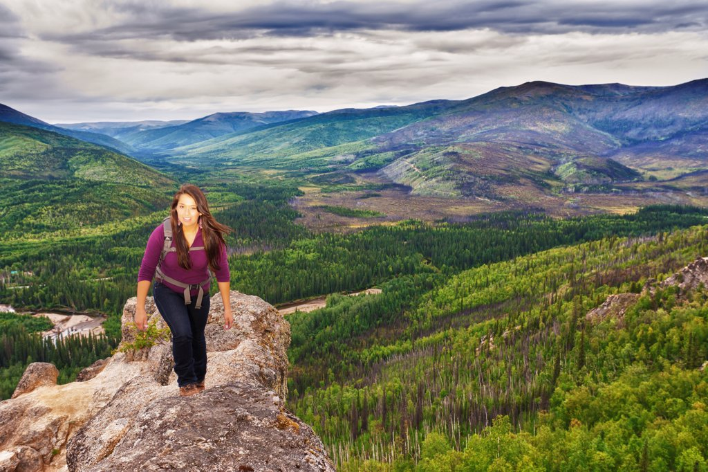 Stock Photo: 4289-13474 Young Alaska Native woman hiking on Angel Rocks above the Chena River, Chena River National Recreation Area, Interior Alaska, Summer