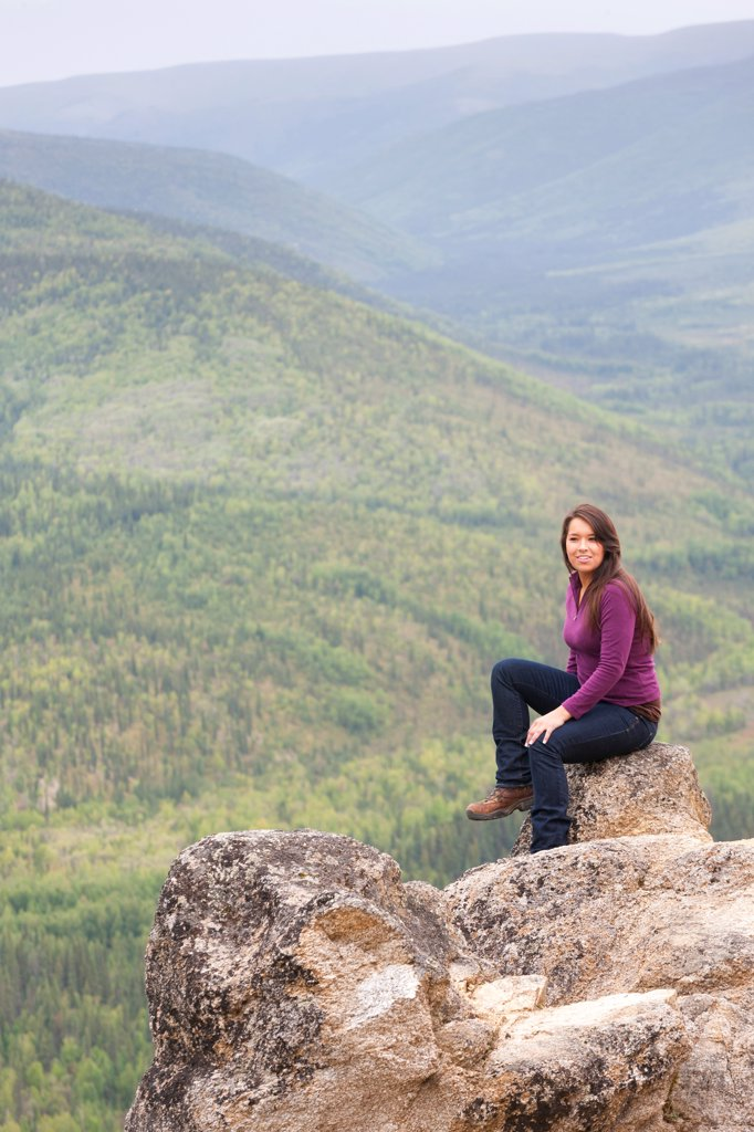 Young Alaska Native woman hiker resting on Angel Rocks above the Chena River, Chena River National Recreation Area, Interior Alaska, Summer : Stock Photo