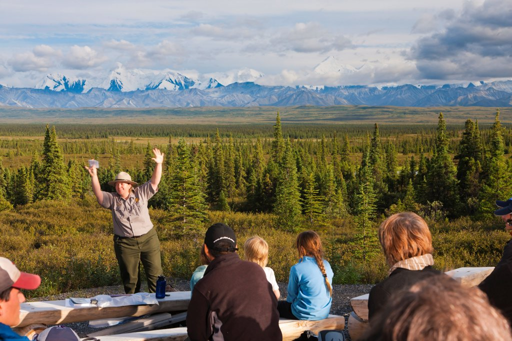 Stock Photo: 4289-13499 Park Ranger giving an evening campfire presentation at Wonder Lake Campground, Denali National Park & Preserve, Interior Alaska, Summer