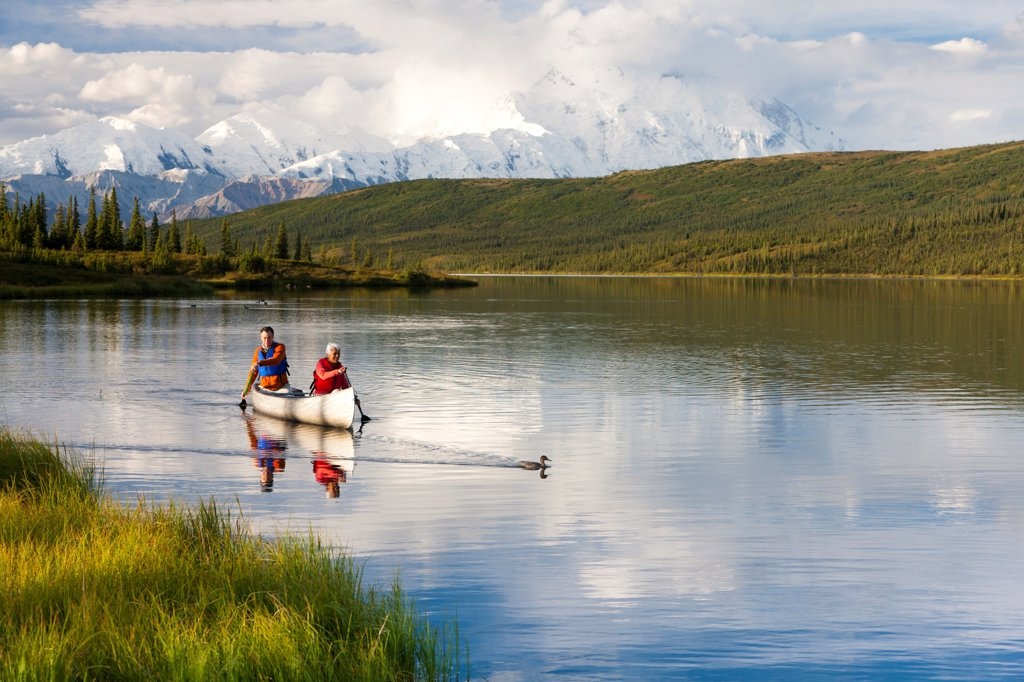 Mature couple canoeing in Wonder Lake, Denali National Park & Preserve, Interior Alaska, Summer : Stock Photo