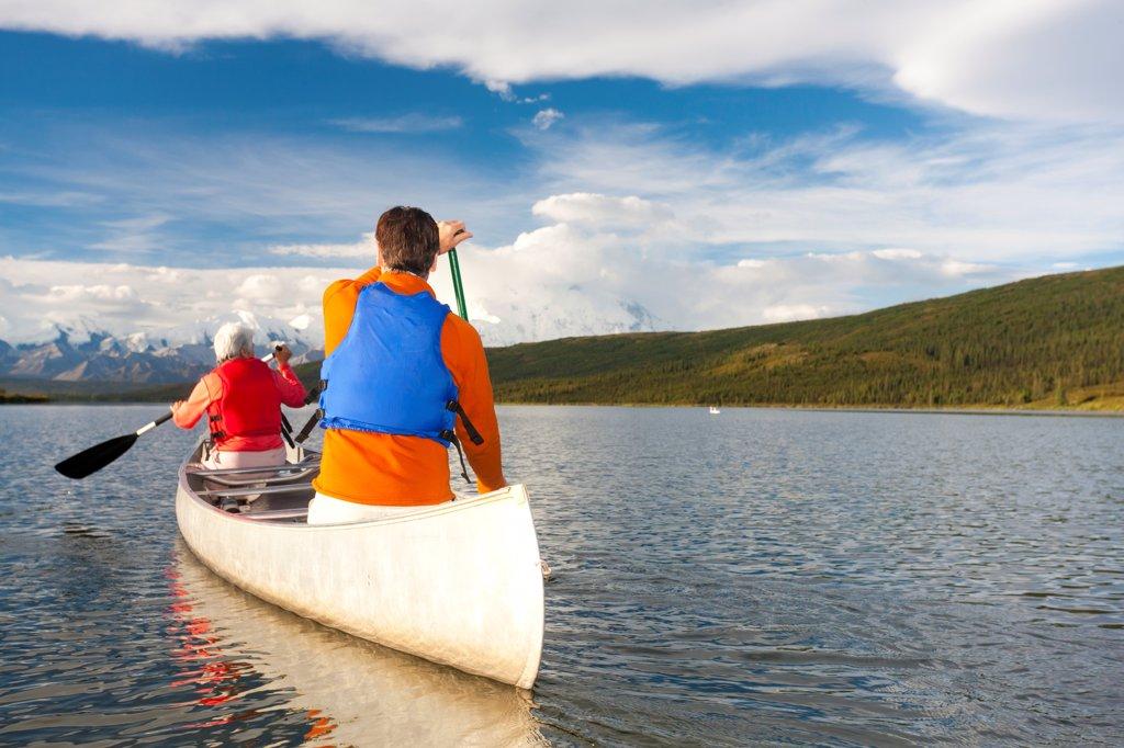 Stock Photo: 4289-13506 Mature couple canoeing in Wonder Lake, Denali National Park & Preserve, Interior Alaska, Summer