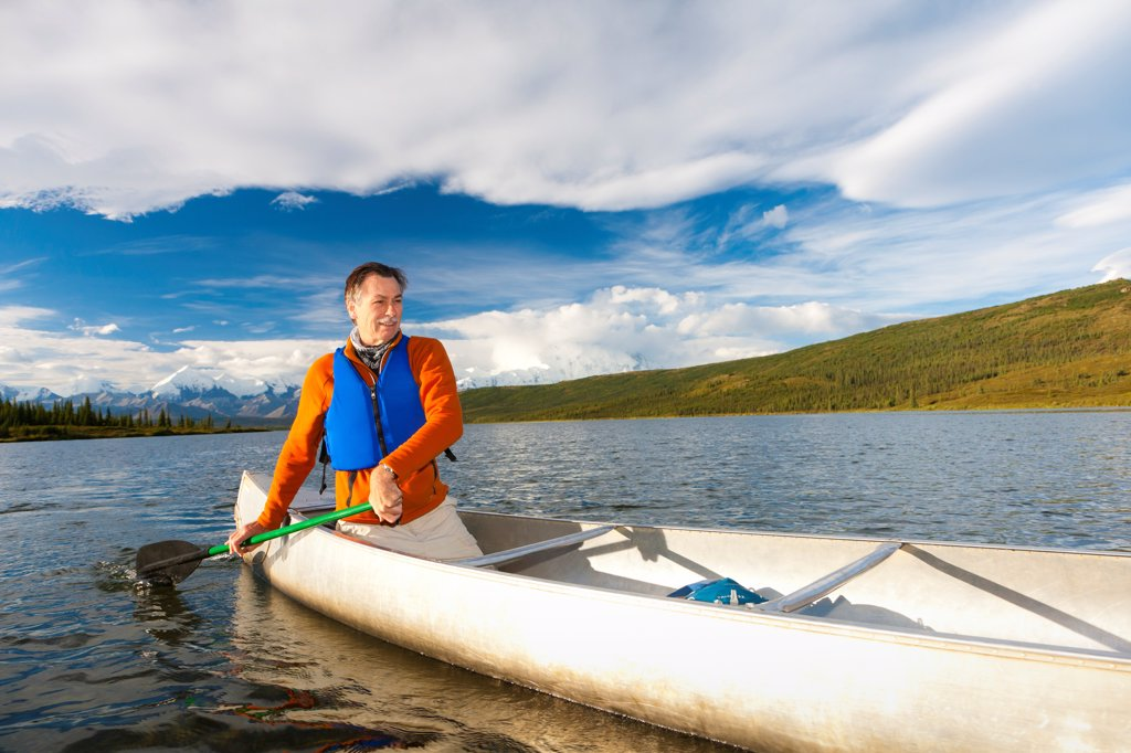 Stock Photo: 4289-13507 Mature man canoeing in Wonder Lake, Denali National Park & Preserve, Interior Alaska, Summer
