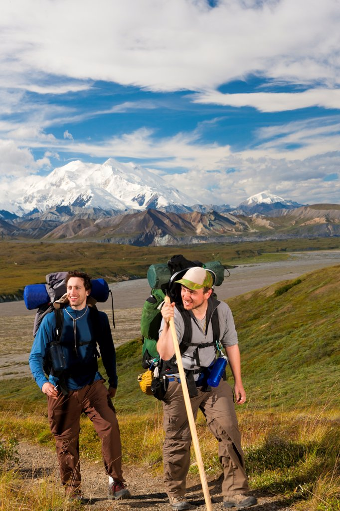 Stock Photo: 4289-13515 Two young adult men returning to Eielson Visitor Center from a backcountry trip, Denali National Park & Preserve, Interior Alaska, Summer