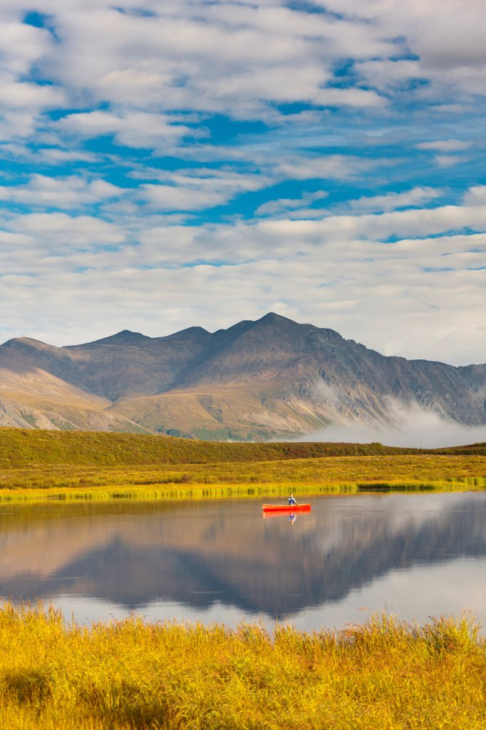 Stock Photo: 4289-13524 Canoeist on a tundra pond along the Denali Highway, near Tangle Lakes, Southcentral Alaska, Autumn