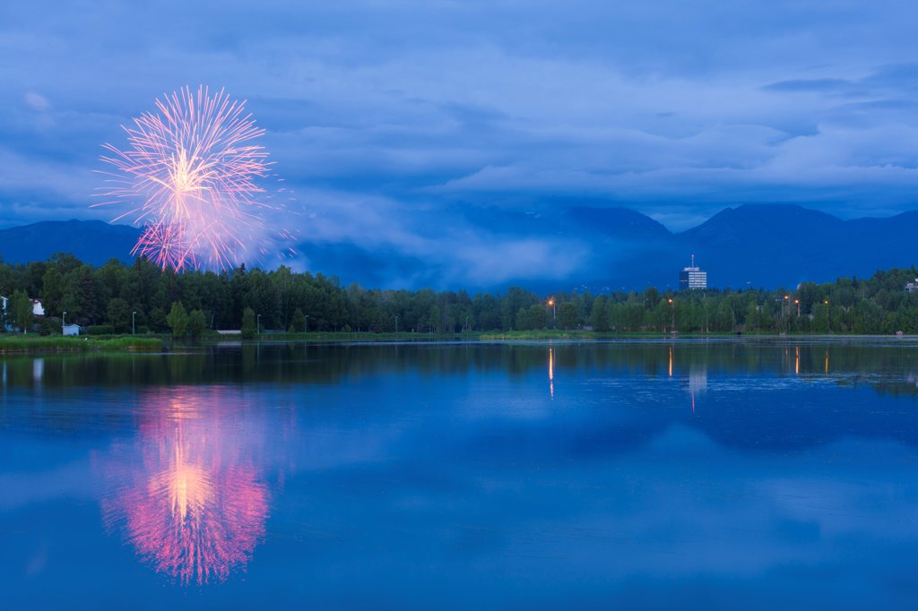 Fireworks over Westchester Lagoon and Anchorage near midnight on July 4th, Southcentral Alaska, Summer : Stock Photo