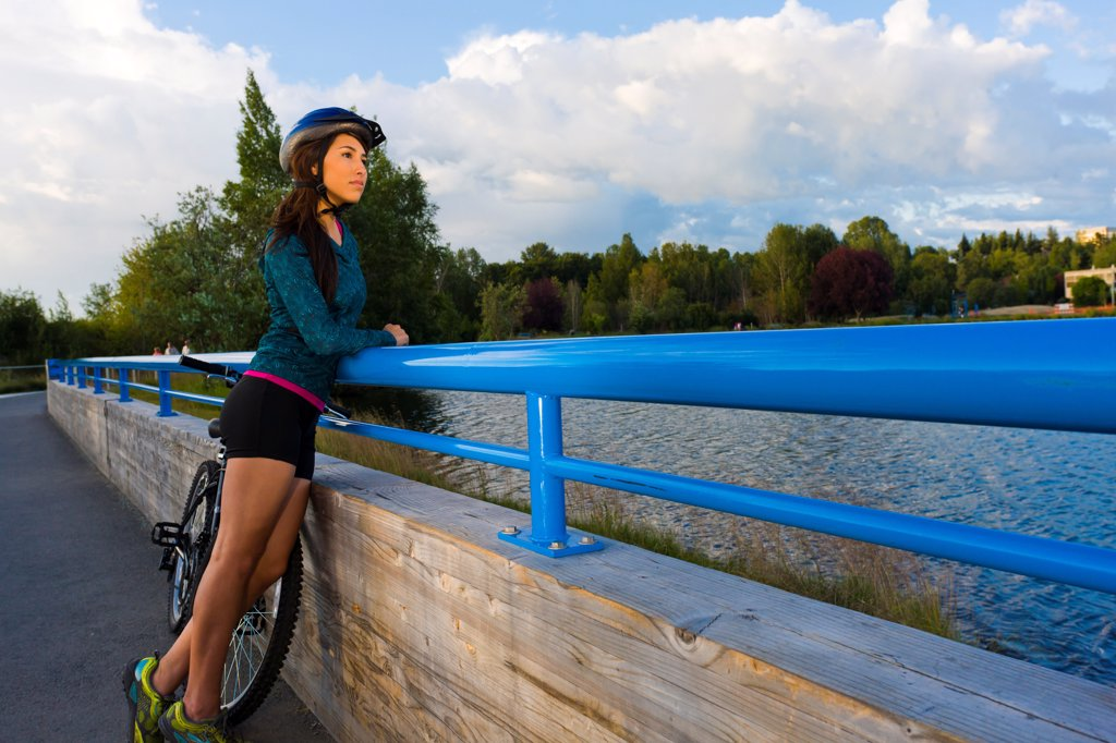 Stock Photo: 4289-13540 Young adult woman enjoying the view along the Tony Knowles Coastal Trail, Anchorage, Southcentral Alaska, Summer