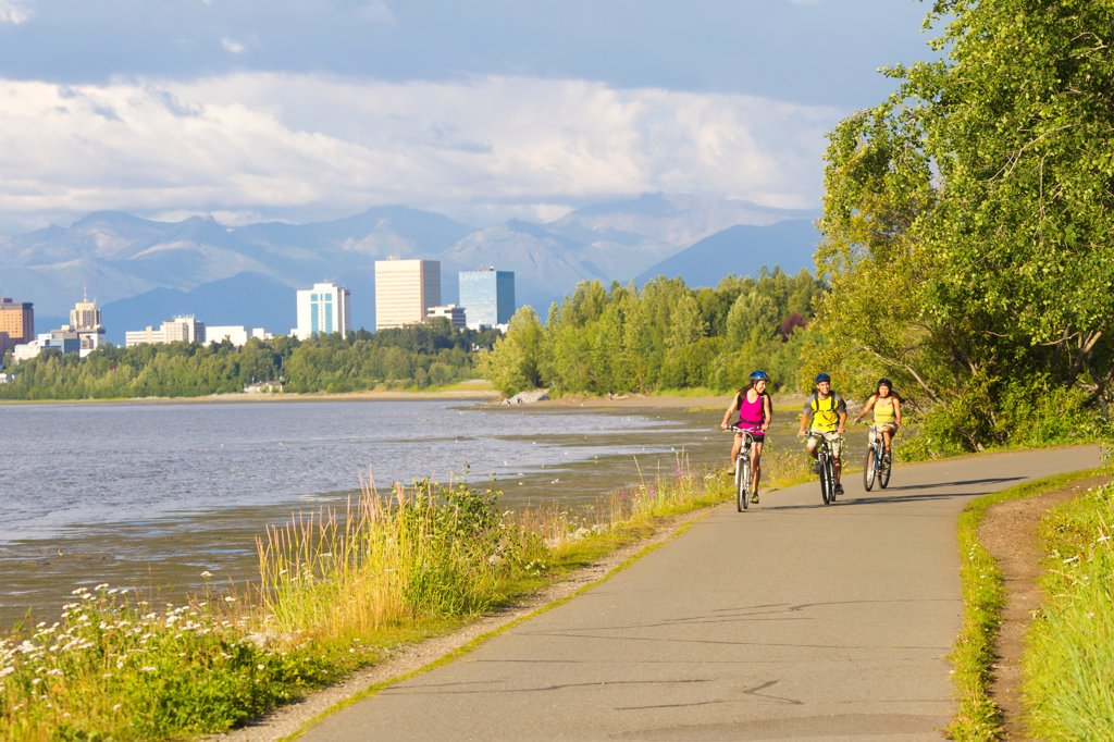 Stock Photo: 4289-13547 Group of young adults riding on the Tony Knowles Coastal Trail along Cook Inlet, Anchorage, Southcentral Alaska, Summer