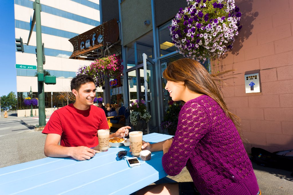 Young adult couple enjoying outdoor cafe and shopping in downtown Anchorage, Southcentral Alaska, summer : Stock Photo