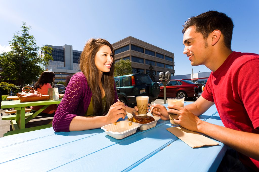 Stock Photo: 4289-13567 Young adult couple enjoying outdoor cafe and shopping in downtown Anchorage, Southcentral Alaska, summer