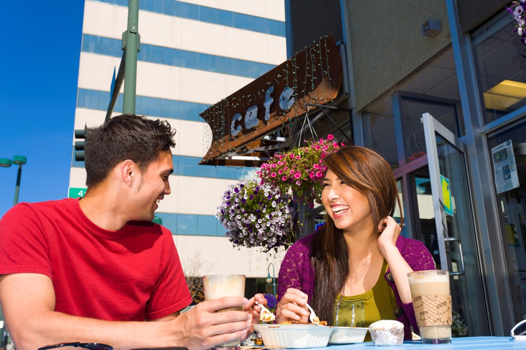 Stock Photo: 4289-13568 Young adult couple enjoying outdoor cafe and shopping in downtown Anchorage, Southcentral Alaska, summer