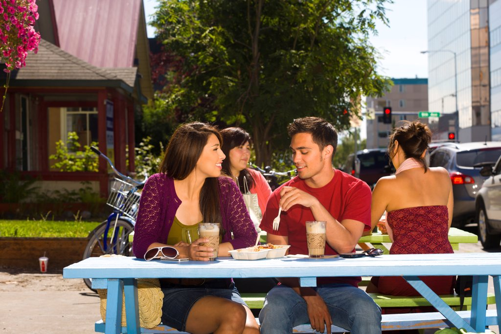 Stock Photo: 4289-13569 Young adult couple enjoying outdoor cafe and shopping in downtown Anchorage, Southcentral Alaska, summer