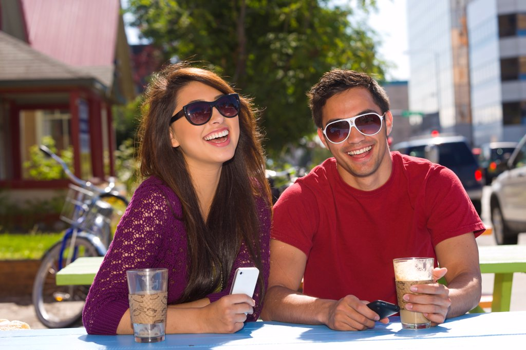 Stock Photo: 4289-13570 Young adult couple enjoying outdoor cafe and shopping in downtown Anchorage, Southcentral Alaska, summer