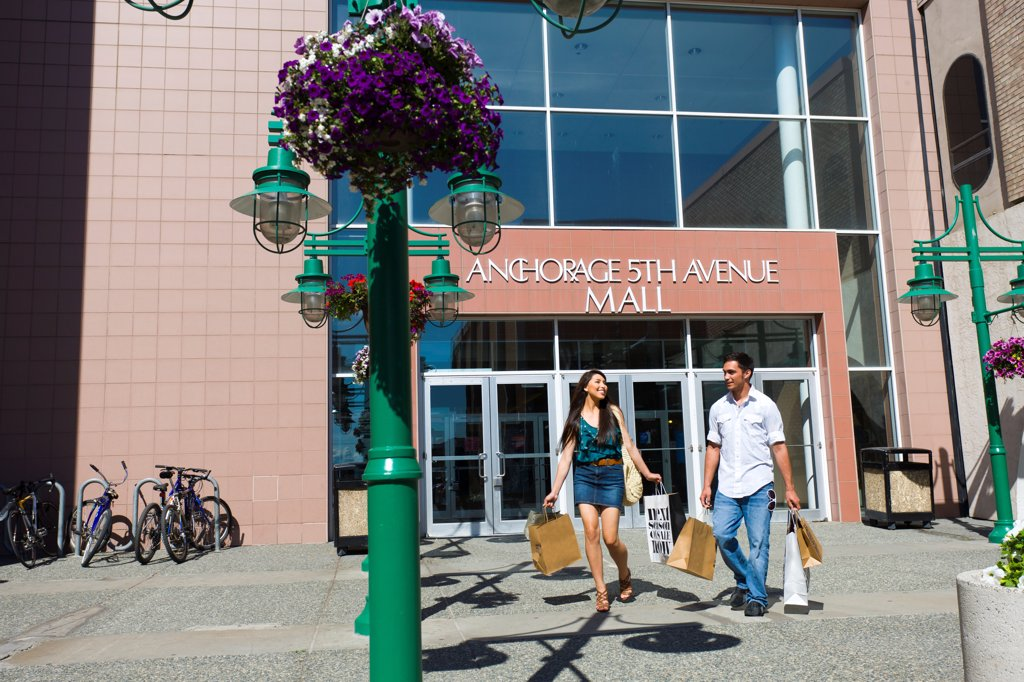 Stock Photo: 4289-13572 Young adult couple shopping in downtown Anchorage, Southcentral Alaska, Summer