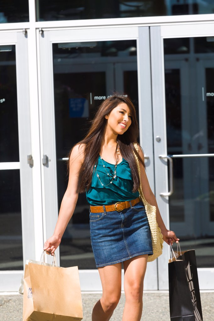 Young adult woman shopping in downtown Anchorage, Southcentral Alaska, Summer : Stock Photo