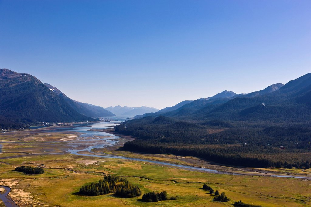 Aerial view looking over the Mendenhall Wetlands State Game Refuge towards the city of Juneau, Southeast Alaska, Summer : Stock Photo
