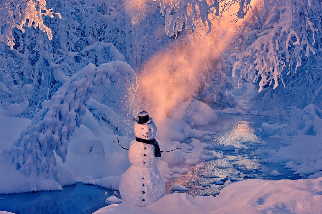 Snowman standing next to a stream with sunrays shining through fog and hoar frosted trees in the background, Russian Jack Springs Park, Anchorage, Southcentral Alaska, Winter. Digitally enhanced. : Stock Photo