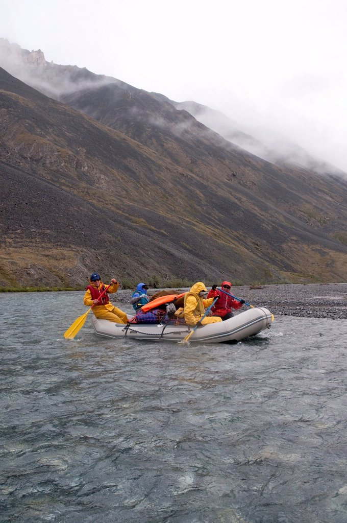 Stock Photo: 4289-13866 People rafting on the Marsh Fork of the Canning River in the Brooks Range, Arctic National Wildlife Refuge, Alaska, Summer