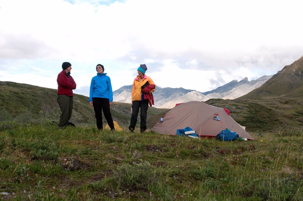 Stock Photo: 4289-13873 Mature female hikers at campsite along the Marsh Fork of the Canning River in the Brooks Range, Arctic National Wildlife Refuge, Alaska, Summer