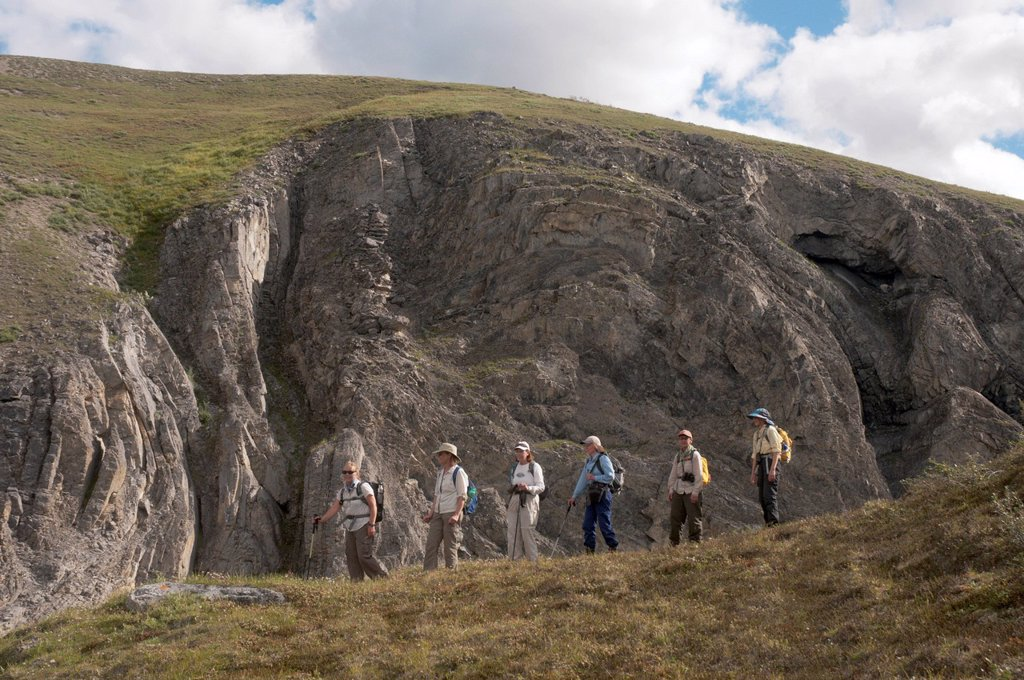 Stock Photo: 4289-13875 Mature female hikers on ridge above the Marsh Fork of the Canning River in the Brooks Range, Arctic National Wildlife Refuge, Alaska, Summer