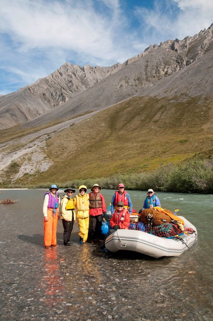 Female rafters take a break on the Marsh Fork of the Canning River in the Brooks Range, Arctic National Wildlife Refuge, Alaska, Summer : Stock Photo