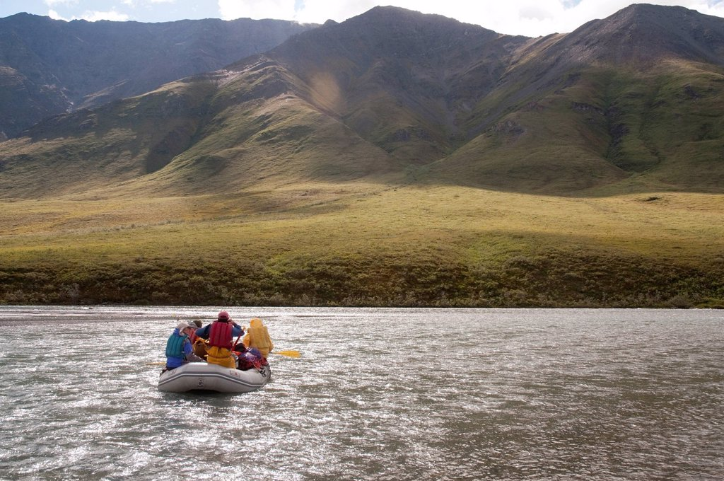 Stock Photo: 4289-13888 People rafting on the Marsh Fork of the Canning River in the Brooks Range, Arctic National Wildlife Refuge, Alaska, Summer
