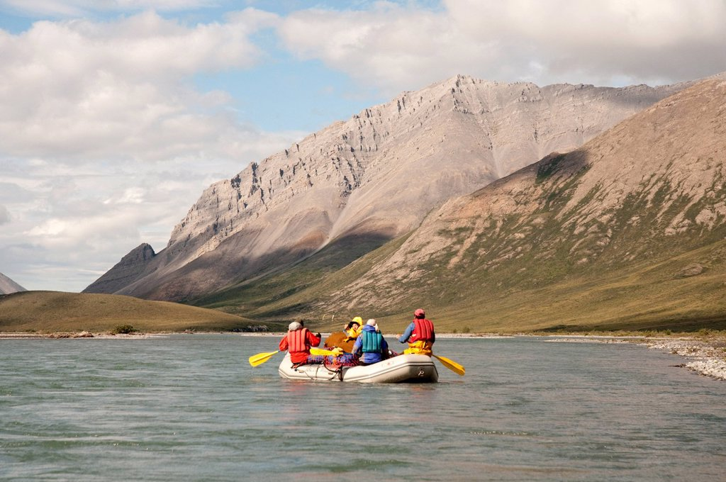 Stock Photo: 4289-13889 People rafting on the Marsh Fork of the Canning River in the Brooks Range, Arctic National Wildlife Refuge, Alaska, Summer