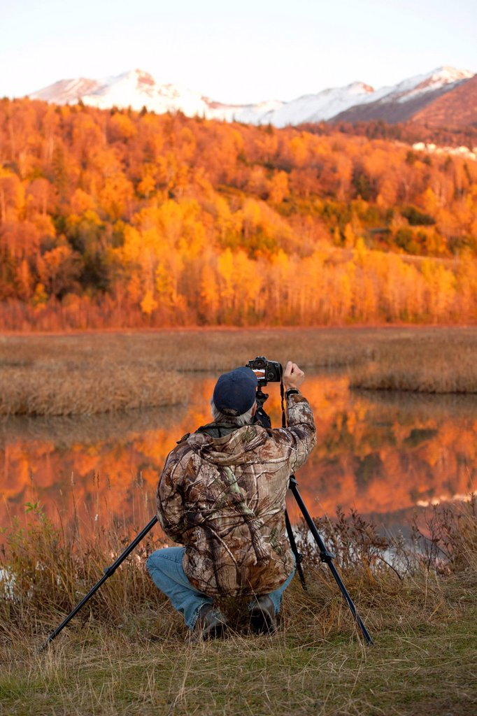 Stock Photo: 4289-13973 Photographer at Potter Marsh at sunset, Southcentral Alaska, Autumn