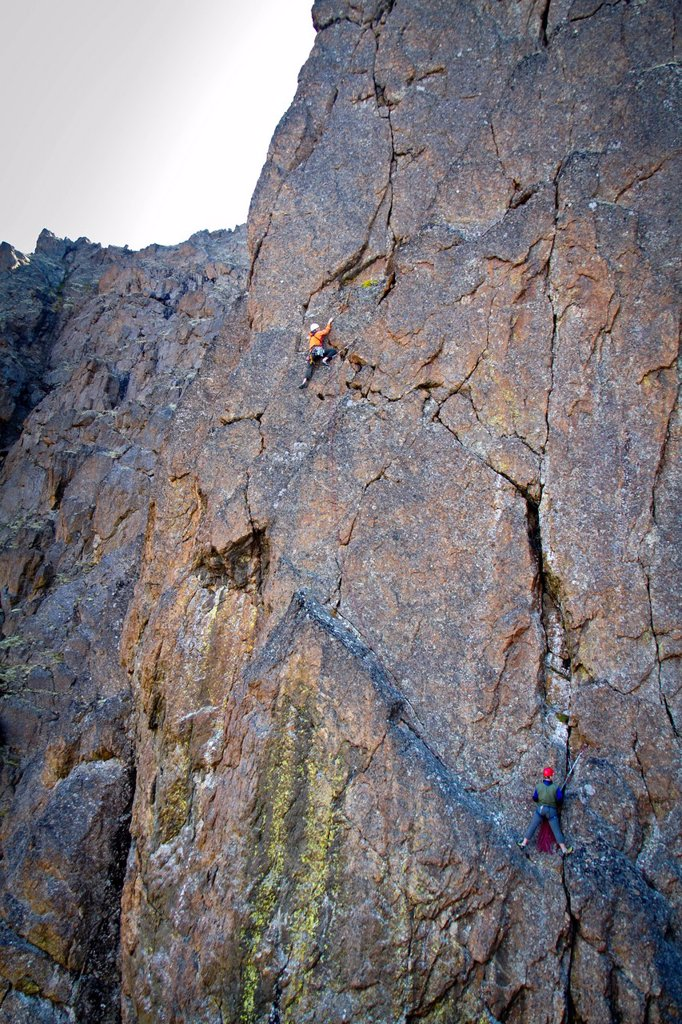 Stock Photo: 4289-14096 Two men rock climbing a vertical rock wall on The Wedge, Chugach Mountains, Southcentral Alaska, Autumn