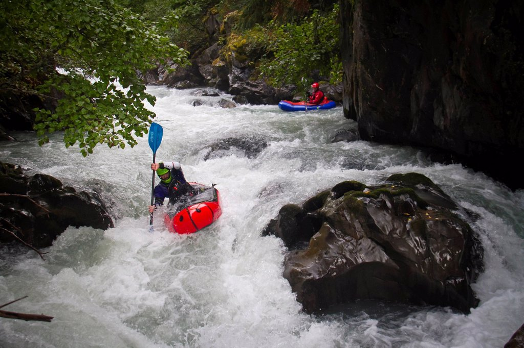 Stock Photo: 4289-14103 Man packrafting whitewater in Bird Creek, Chugach Mountains, Southcentral Alaska. Summer