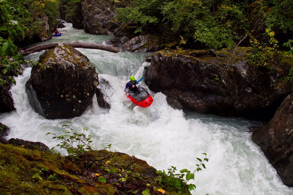 Man packrafting whitewater in Bird Creek, Chugach Mountains, Southcentral Alaska. Summer : Stock Photo
