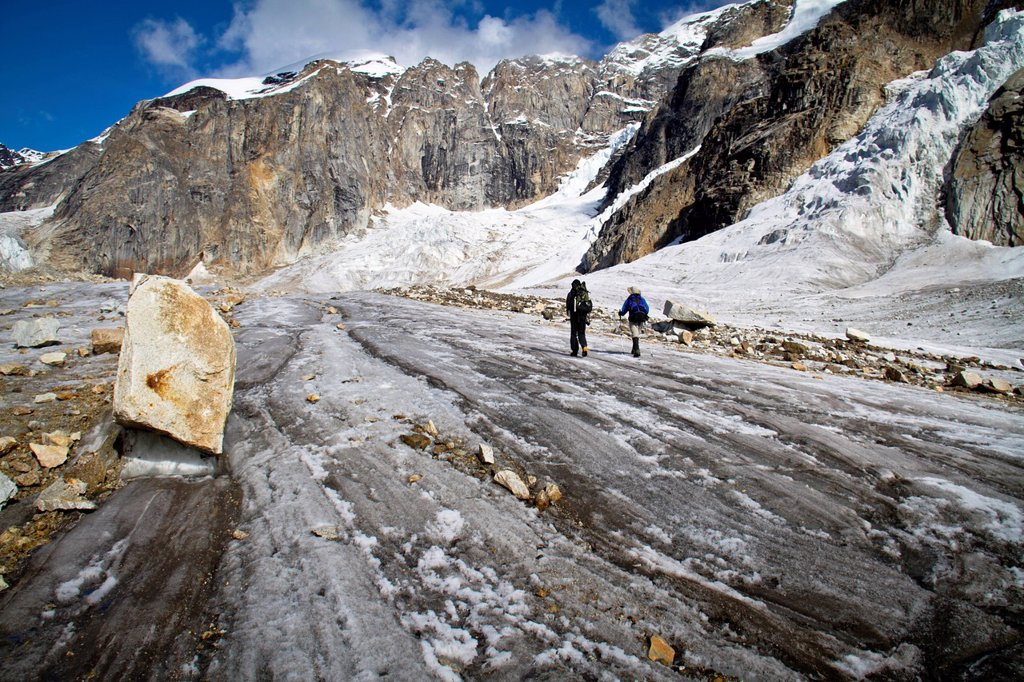 Two men hiking the Backside Glacier, Denali National Park & Preserve, Alaska Range, Interior Alaska, Autumn : Stock Photo