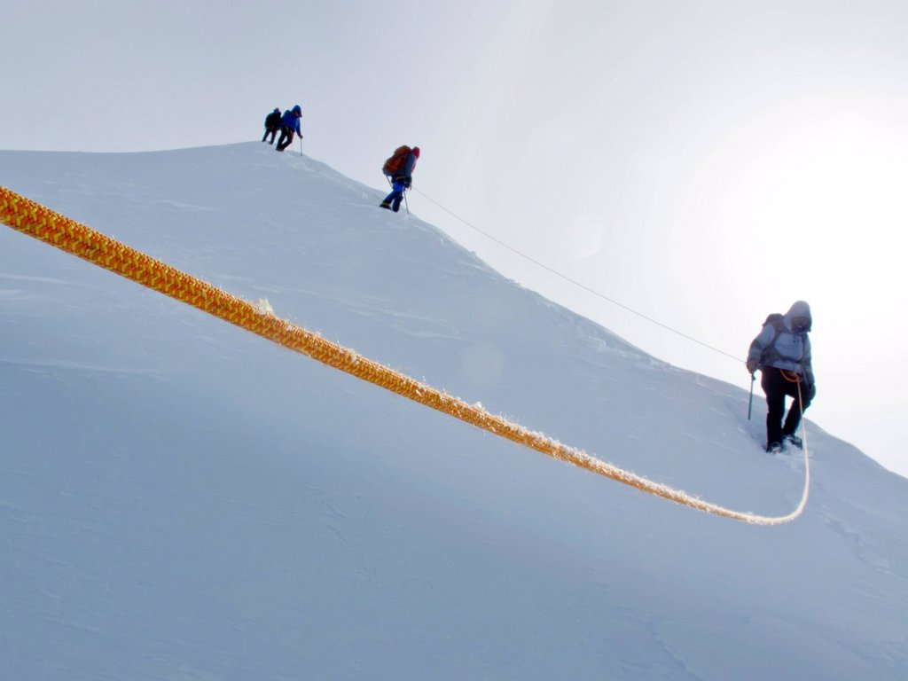 Group of mountaineers descending the summit ridge along the King Trench route on Mt. Logan, Kluane National Park, Saint Elias Mountains, Yukon Territory, Canada, Summer : Stock Photo