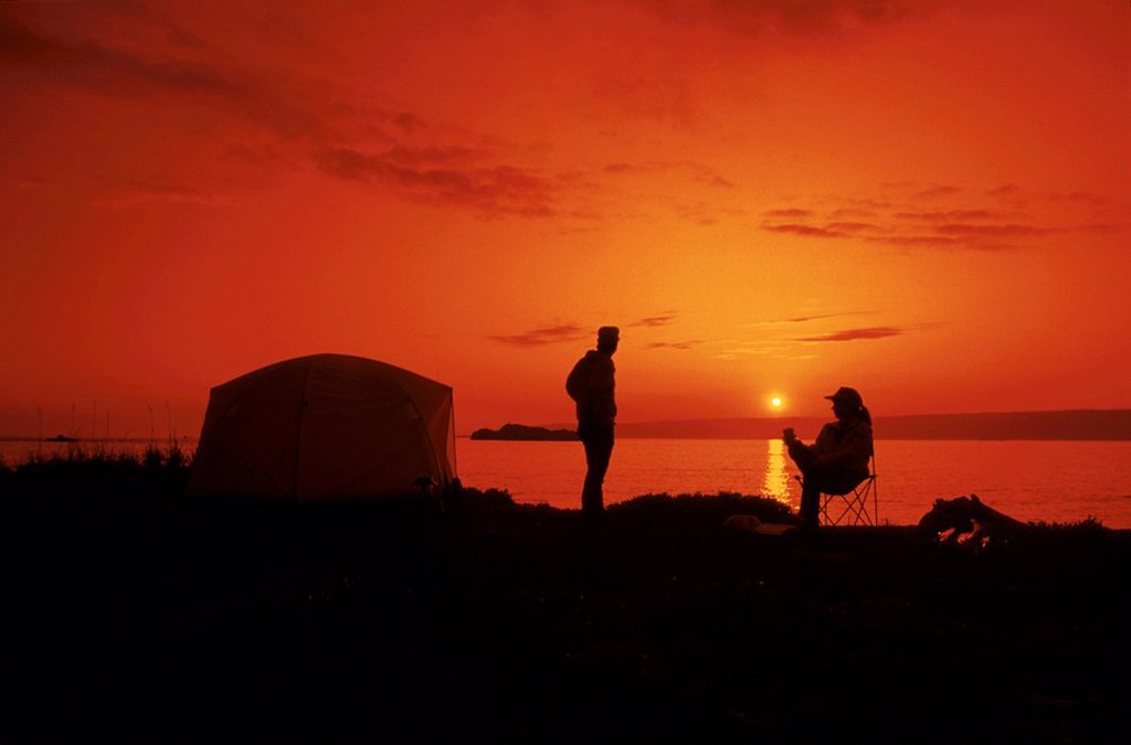 Kachemak Bay near Homer Sunset Campers by tent AK Southcentral Summer Scenic Silhouette : Stock Photo
