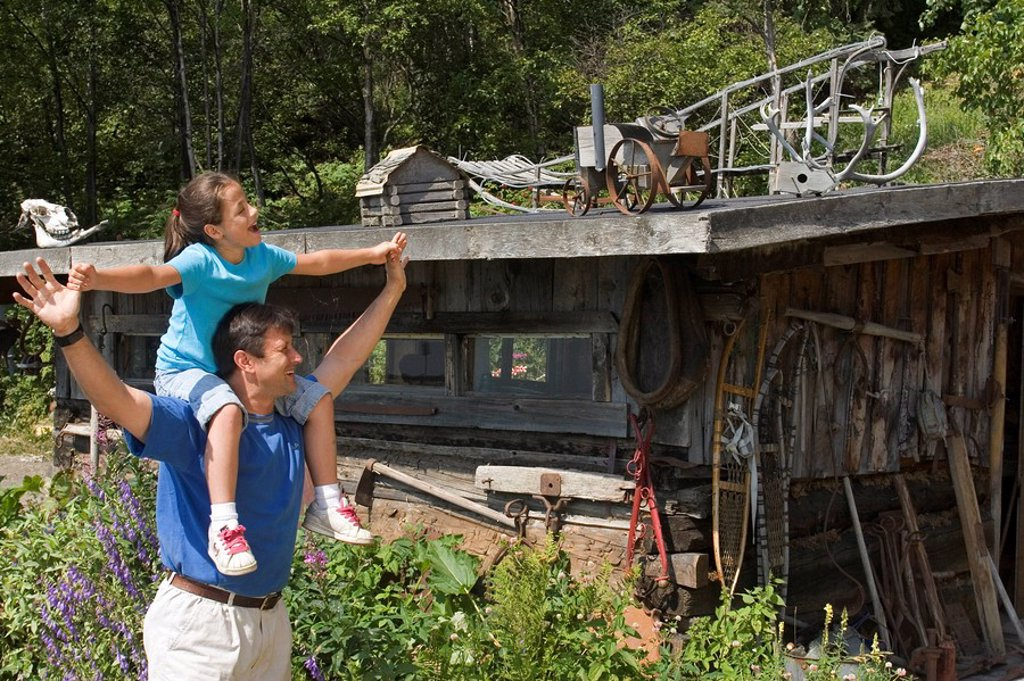 Stock Photo: 4289-24484 Tourist family visiting Indian Valley Gold Mine, SC Alaska, near Anchorage. Chugach Mountains.