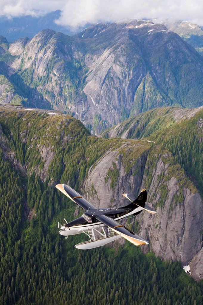 Stock Photo: 4289-26304 Turbine Otter floatplane over Walker Cove, Misty Fiords National Monument Wilderness, Southeast, Alaska