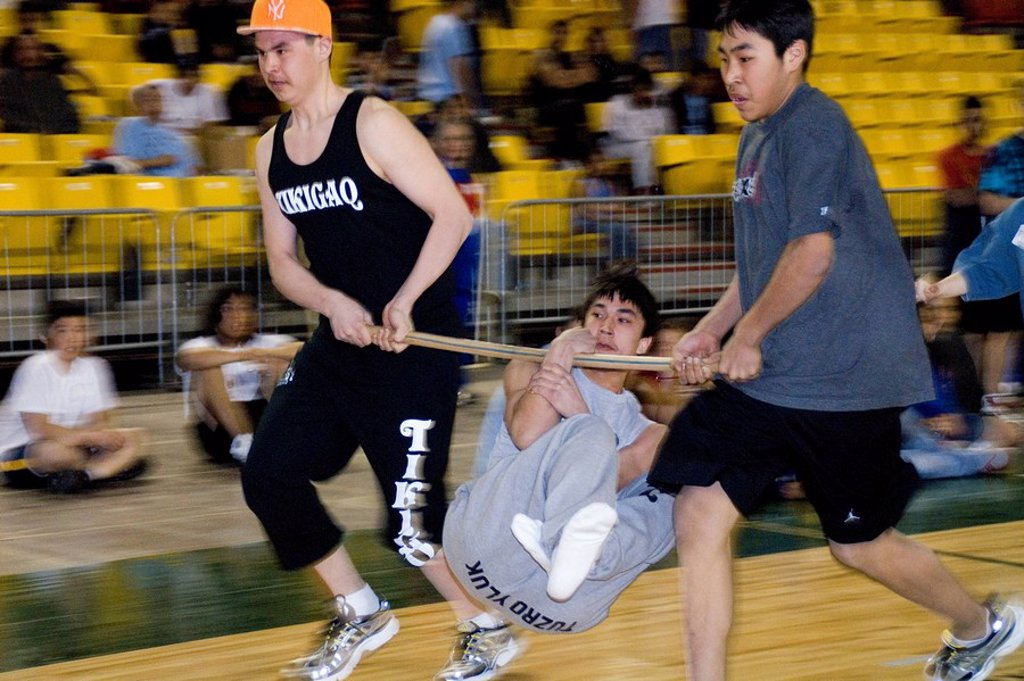 Boy´s doing Wrist Carry 2006 Senior Native Youth Olympic Games Alaska Anchorage Sullivan Arena : Stock Photo