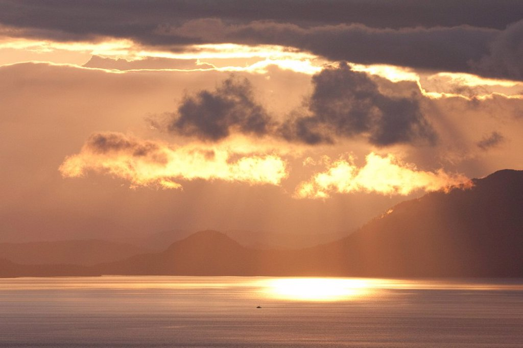 Sunset and clouds in Clarence Strait, Southeast, Alaska. : Stock Photo