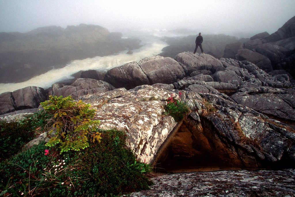 Stock Photo: 4289-29397 Hiker stands at Tree Point, Dixon Entrance, overlooking Misty Fiords National Monument Wilderness, Southeast, Alaska