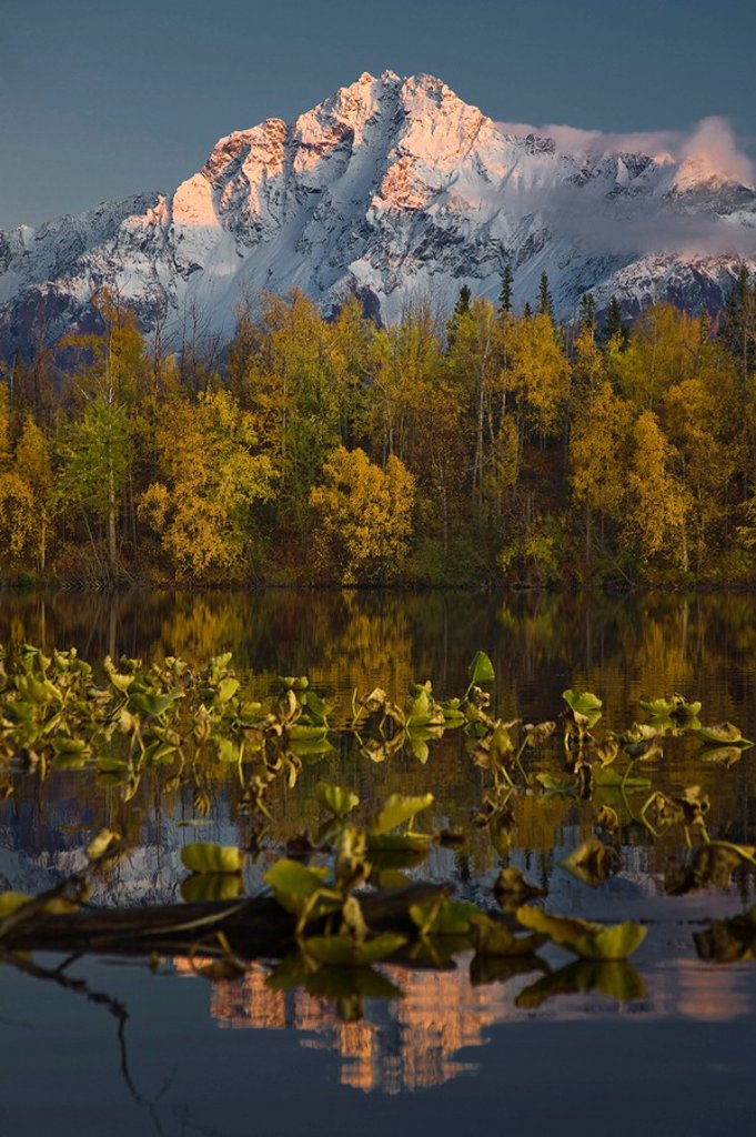 Scenic view of Pioneer Peak reflecting in Echo Lake at sunset, Southcentral, Alaska : Stock Photo