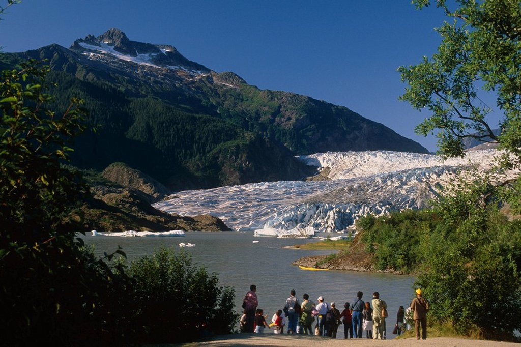 Stock Photo: 4289-30930 Visitors viewing Mendenhall Glacier from shoreline of Lake Southeast Alaska Summer Tongass Nat Forest