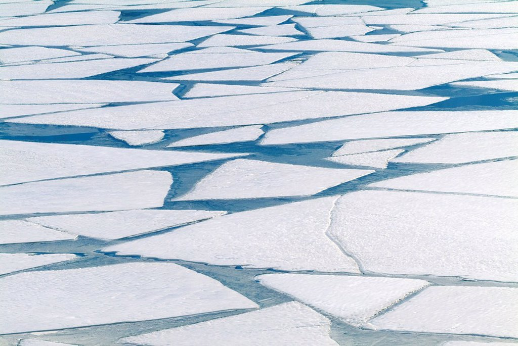 Winter ice layer on Portage Lake breaking up w/spring thaw Southcentral Alaska Portage Valley : Stock Photo