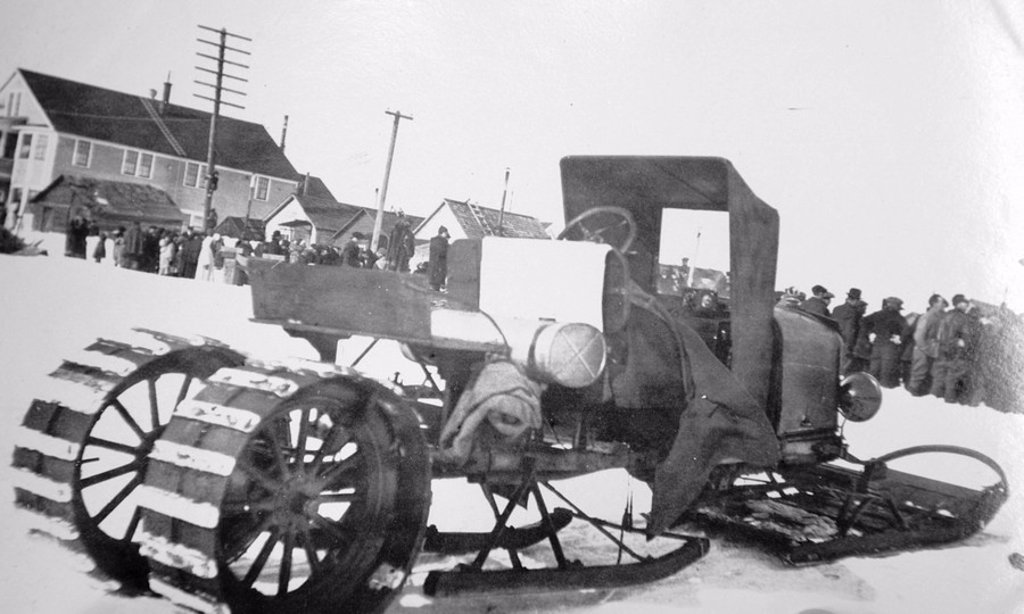 Historical image of a early example of a vehicle modified for winter use in snow winter Nome WE Alaska : Stock Photo