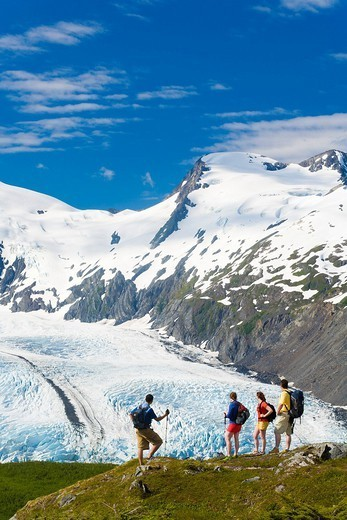 Group of hikers enjoying the view of Portage Glacier at Portage Pass, Chugach National Forest, Southcentral Alaska, Summer : Stock Photo