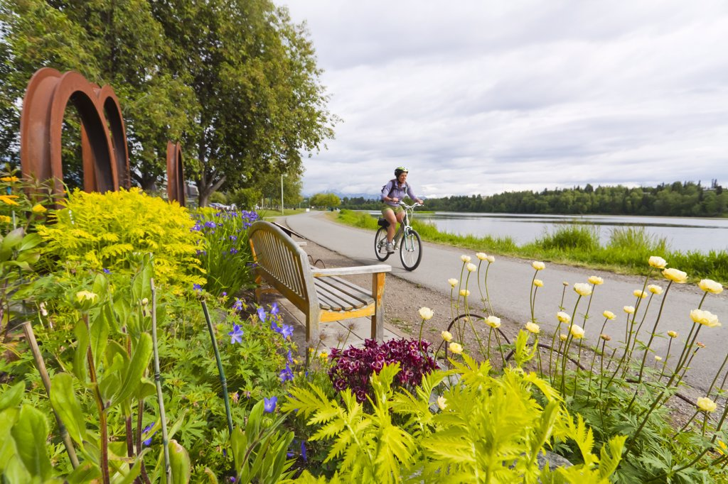 Stock Photo: 4289-9805 Cyclists on the Tony Knowles Coastal Trail near Westchester Lagoon, Anchorage, Southcentral Alaska, Summer