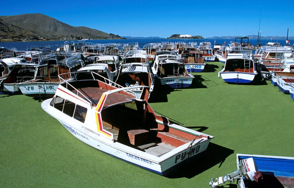 Boats moored in Puno Harbour, on Lake Titicaca, Puno, Peru : Stock Photo