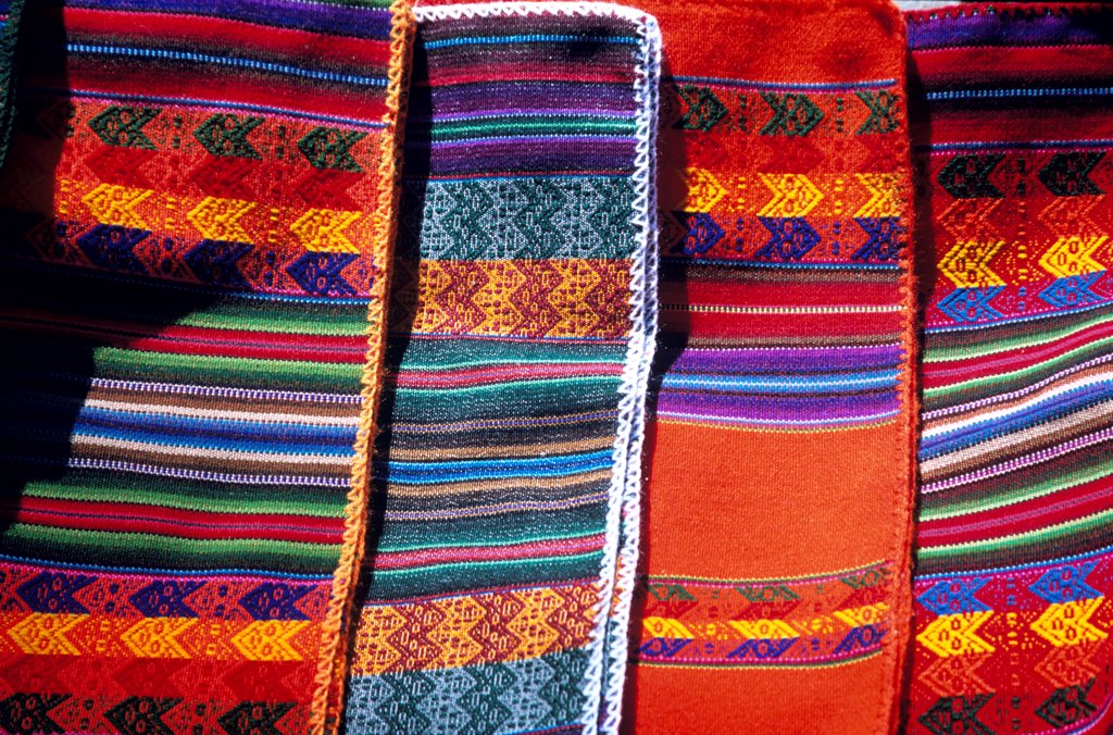 Colourful woven fabric for sale, Sun Island, on Lake Titicaca, near Copacabana, Bolivia : Stock Photo
