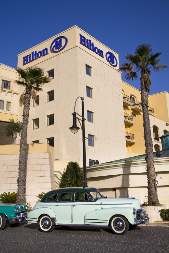 Stock Photo: 4290-1346 Chevrolet Fleetmaster car parked outside the Malta Hilton Hotel, Portomaso, Saint Julian's, Malta