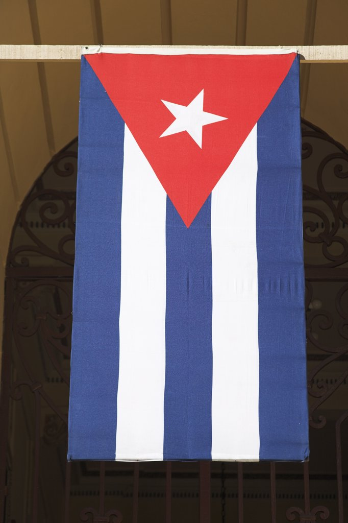 Cuban flag suspended from the Palacio Provincial, Santiago de Cuba, Cuba : Stock Photo