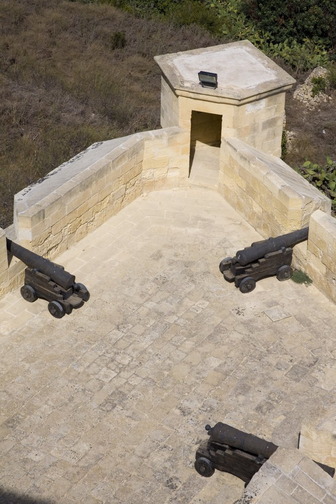 Overlooking the fortifications and cannons in the Citadel, Victoria, Gozo, Malta : Stock Photo